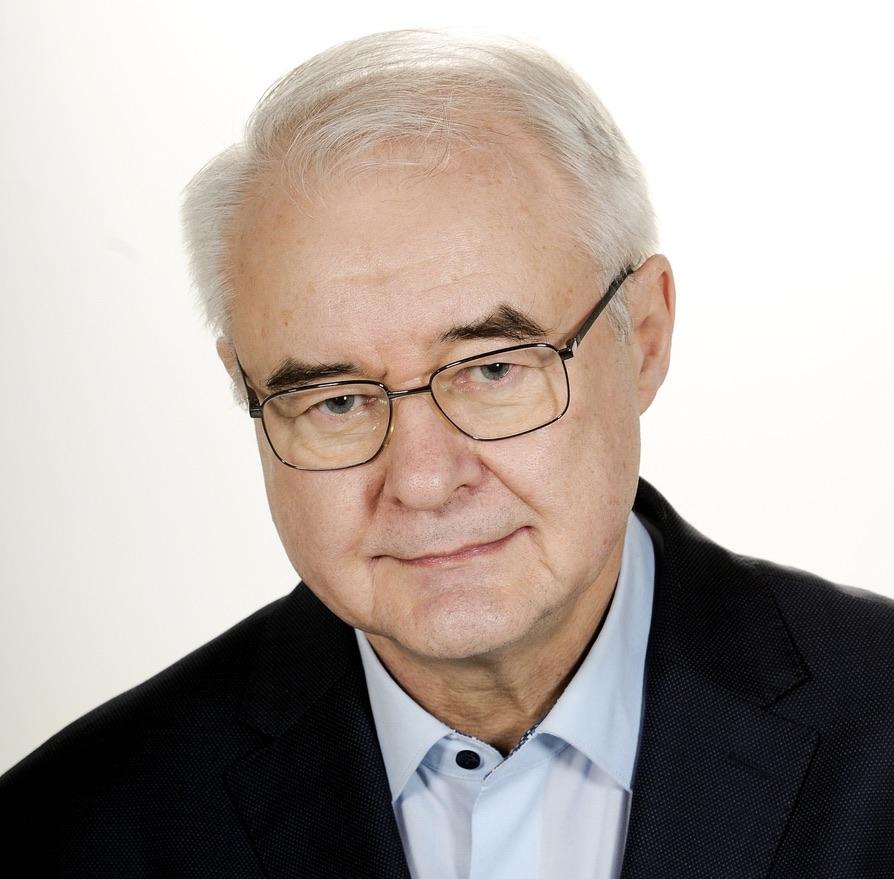 zdjęcie portretowe profesora PAwła Dybla